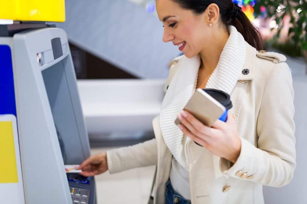 Woman using an ATM Machine